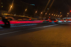 Auto, city street lights and speed. Abstract blurred colorful background of urban street night traffic with bokeh lights Stock Photography