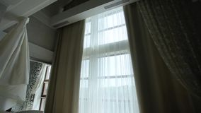Auto-closing curtains in the apartment with a large window stock footage