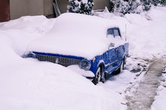 Auto covered  snow. Blue auto covered with snow Royalty Free Stock Image