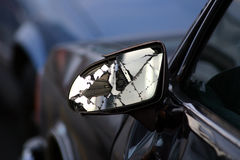 Auto crack up. Close up of a smashed mirror and car that was in a bad accident Royalty Free Stock Photo