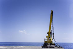 Auto Crane On A Sea Stock Images