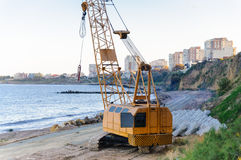 Auto crane work construction site beach sea Royalty Free Stock Photo