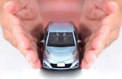 Auto in der Hand Lizenzfreies Stockfoto