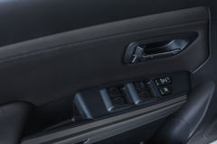 Auto door handle. Car interior detail. Royalty Free Stock Photo