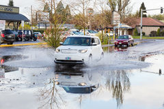 Auto Driving in Puddle After Big Rain Stock Photos