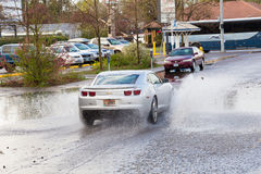 Auto Driving in Puddle After Big Rain Royalty Free Stock Photos