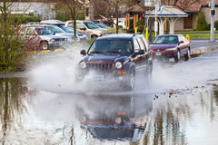 Auto Driving in Puddle After Big Rain Stock Images