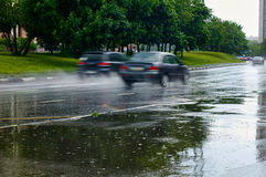Auto Driving under the rain Stock Photos