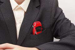 Auto in een jasjezak (concept) Stock Fotografie