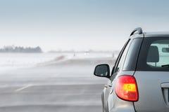 Auto in einem Blizzard Lizenzfreie Stockfotos