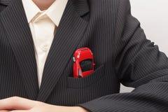 Auto in einer Jackentasche (Konzept) Stockfotografie