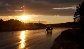 Auto en de zon Stock Foto's