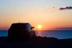 Auto en zonsondergang Stock Foto