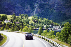 Auto going on a road winding between mountains Stock Photography
