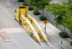 Auto hauler with trailer. Auto hauler truck in yellow color ready to load cars Stock Photography