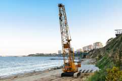 Auto heavy machinery crane construction site sea Royalty Free Stock Photography
