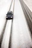 Auto in het Onweer van de Sneeuw Stock Foto's