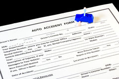 Auto insurance accident form and toy car Royalty Free Stock Image
