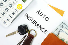 Auto insurance with car key and money. Auto insurance with car key, money in wallet and calculator Royalty Free Stock Images