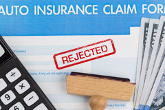 Auto insurance claim form. With dollar and calculator Royalty Free Stock Photos
