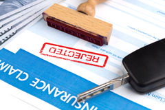 Auto insurance claim form. With dollar and car key Royalty Free Stock Images
