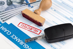 Auto insurance claim form. With dollar and car key Stock Photo