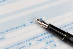 Auto insurance claim form. With fountain pen Stock Images