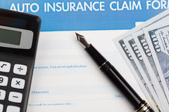 Auto insurance claim form. With fountain pen and dollar Stock Images