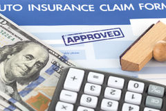 Auto insurance claim form. With stamp approved Royalty Free Stock Photo