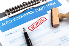 Auto insurance claim form. With stamp rejected Royalty Free Stock Photography