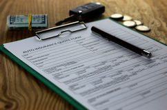 Auto insurance contract money. Different documents auto insurance contract on a table Stock Image