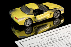 Auto insurance form and damaged car Royalty Free Stock Images