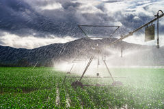 Auto irrigation systems on french rural fields. Agricultural con Stock Photography