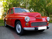 Red old car Polisch Warsaw. Warsaw, the now historic car Stock Photo