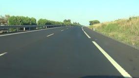 Auto 4K fährt auf Autobahnrichtung zu Nationalpark Doñana, natürliche Reserve stock video