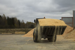 Auto Loader with Scoop Full of Sawdust Royalty Free Stock Images