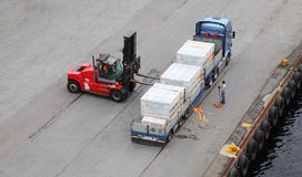Auto-loader unload truck, labourer help Royalty Free Stock Photo