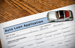 Auto Loan Application. With toy sports car stock photography