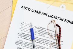 Auto loan form. Auto loan application form with manila envelop and pen stock photo