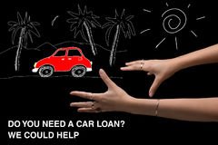 Auto Loan. A girl dreams of a red car and takes her into a car l royalty free stock images