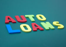 Auto Loans with wooden alphabet Royalty Free Stock Photos
