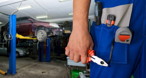 Auto mechanic. Closeup standing in his workshop Royalty Free Stock Photos