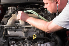 Auto Mechanic. A mechanic diagnosing engine problems Royalty Free Stock Image