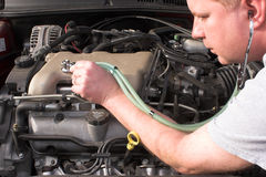Auto Mechanic. A mechanic diagnosing engine problems Stock Image