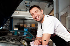 Auto mechanic based on car Royalty Free Stock Photos