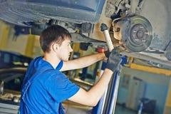 Auto mechanic at brake check Stock Photos