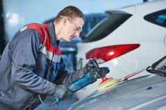 Auto mechanic buffing car autobody Royalty Free Stock Image