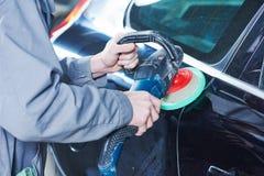 Auto mechanic buffing car autobody Royalty Free Stock Photos