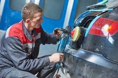 Auto mechanic buffing car autobody Stock Image