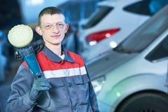 Auto mechanic with buffing machine Stock Photography